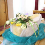 coffin with flower wreath
